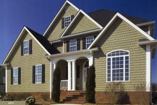 Частный дом, облицованный фасадными панелями под кирпич