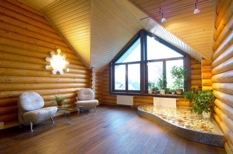 Дизайн интерьера зала в загородном доме при помощи блок хауса