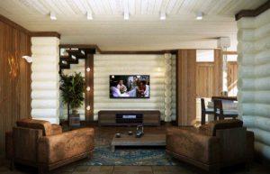 Изюминкой этого оформления является контраст между светлыми бревнами и коричневым цветом мебели