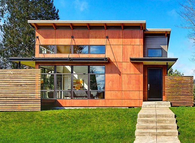 Панели из древесных волокон признаны наиболее экологичными для обшивки домов