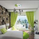 Уютный дизайн зеленой квартиры