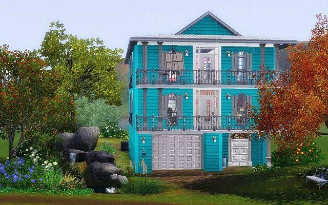 Частный дом бирюзового цвета с красивым дизайном