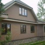 Дизайн фасада дома коричневого цвета