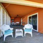 Пример экстерьера оранжевого дома