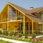 Приятный дизайн современного желтого дома