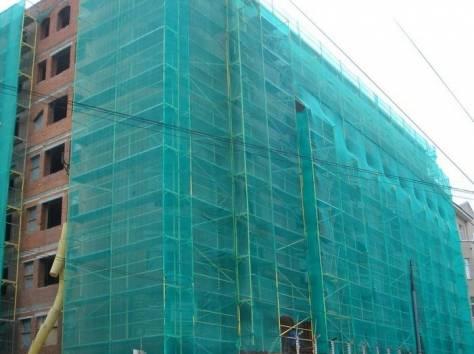 Простая защита для фасада при ремонте или строительстве зданий